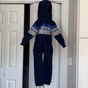 Blue zip-up.